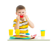 Happy kid with colorful clay toy Royalty Free Stock Image