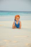 Happy kid crawling on the beach Royalty Free Stock Photography