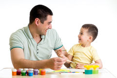 Happy kid and dad paint together. Happy kid and dad painting together Royalty Free Stock Photo