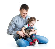 Happy kid and dad play with kitten Stock Photo