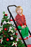 Happy kid and decorated Christmas tree Royalty Free Stock Photo