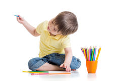 Happy kid drawing with pencils in album Stock Photography