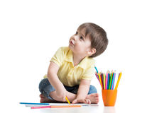 Happy kid drawing with pencils in album Royalty Free Stock Photography