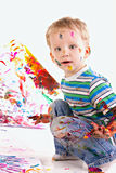 Happy kid is drawing picture Royalty Free Stock Image