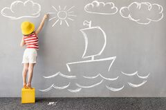 Free Happy Kid Draws A Chalk Ship On The Wall Royalty Free Stock Image - 218530886
