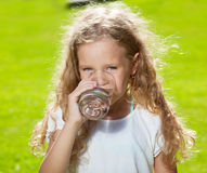 Happy kid drinking water stock photography