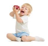Happy kid eating apple Stock Image