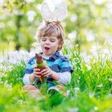 Happy kid eating chocolate ice cream Stock Photography