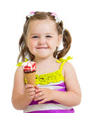 Happy kid eating ice cream isolated Royalty Free Stock Photography