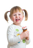 Happy kid eating ice cream isolated Stock Images