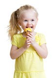 Happy kid eating ice cream in studio isolated Royalty Free Stock Images