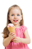Happy kid eating ice cream in studio isolated Royalty Free Stock Photo