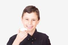 Happy kid eating kahk el Eid Royalty Free Stock Images