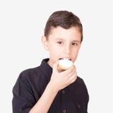 Happy kid eating kahk el Eid Royalty Free Stock Image