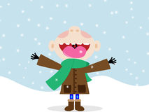 Happy kid eating snowflakes. A happy boy in snow Royalty Free Stock Images
