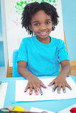 Happy kid enjoying arts and crafts painting stock images