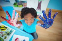 Happy kid enjoying arts and crafts painting. With his hands royalty free stock photography