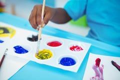 Happy kid enjoying arts and crafts painting Royalty Free Stock Photos