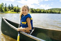 Free Happy Kid Enjoying Canoe Ride On Beautiful River Royalty Free Stock Photo - 129238655