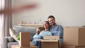 Happy kid exploring new house with parents on moving day