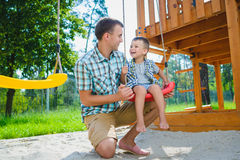 Happy kid and father having fun. Child with dad playing stock images