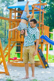 Happy kid and father having fun. Child with dad playing stock photos