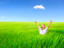 Happy kid in the field Royalty Free Stock Images
