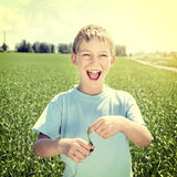 Happy Kid at the Field Royalty Free Stock Image