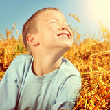 Happy Kid in the Field Royalty Free Stock Image
