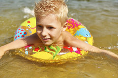 Happy kid with floating ring Royalty Free Stock Images