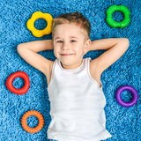 Happy kid on floor in living room at home Royalty Free Stock Photo