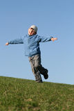 Happy kid flying on blue sky Royalty Free Stock Images