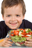 Happy kid with fruit salad Stock Images