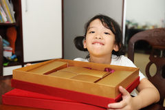 Happy kid with gift box Royalty Free Stock Photos