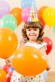 Happy kid girl on birthday party. Joyful kid girl on birthday party stock photo