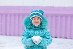 Happy kid girl child outdoors in winter Royalty Free Stock Photography