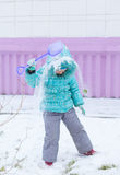 Happy kid girl child outdoors in winter playing Stock Images