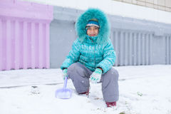 Happy kid girl child outdoors in winter playing Stock Photo
