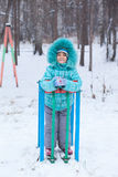Happy kid girl child outdoors in winter Stock Image