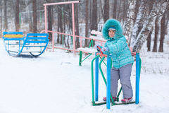 Happy kid girl child outdoors in winter playing Royalty Free Stock Images