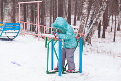 Happy kid girl child outdoors in winter playing and training Royalty Free Stock Photos