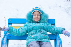 Happy kid girl child outdoors in winter Royalty Free Stock Photo