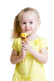 Happy kid girl eating ice cream isolated Stock Photo