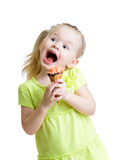 Happy kid girl eating ice cream isolated Royalty Free Stock Photo