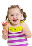Happy kid girl eating ice-cream Stock Image