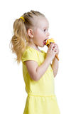 Happy kid girl eating icecream in studio isolated Stock Photo