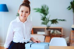 Happy kid girl with gift for birthday or womans day posing at home Stock Images
