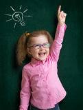 Happy kid girl in glasses with bright idea Royalty Free Stock Photos