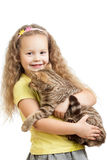 Happy kid girl holding cat isolated on white Royalty Free Stock Photos