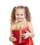 Happy kid girl holding gift box isolated Stock Images